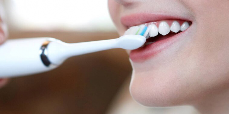 Brushing with Sonicare Toothbrush